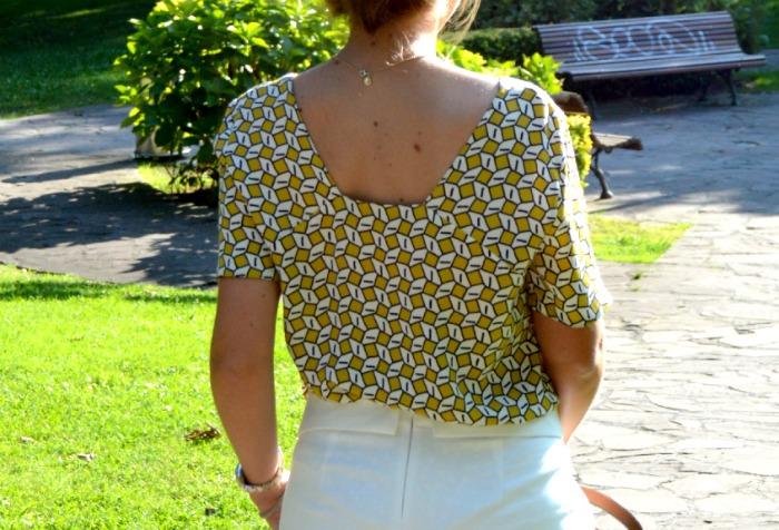 Top geométrico amarillo aceite skort blanca zara